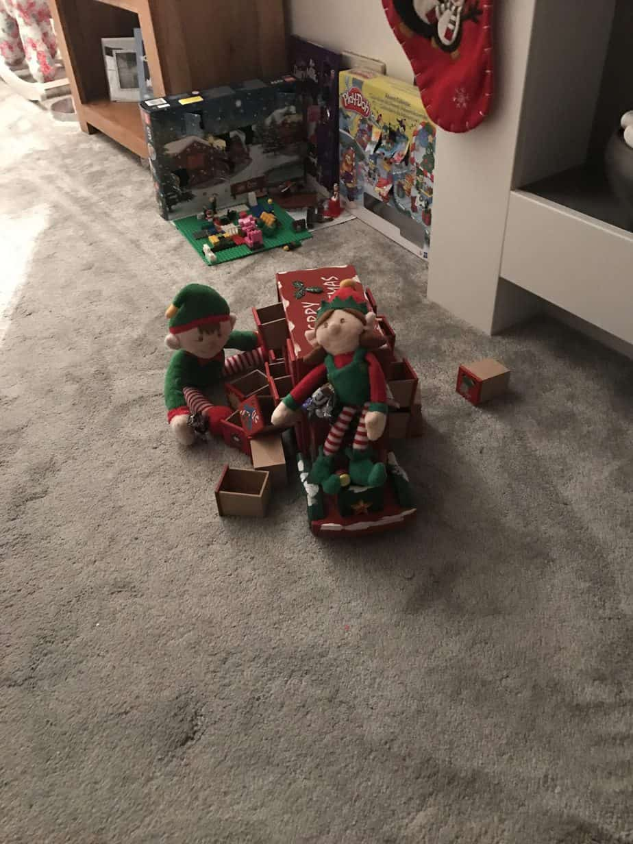 Elf on the shelf ideas -get your elf to open up the kids advent calendars!