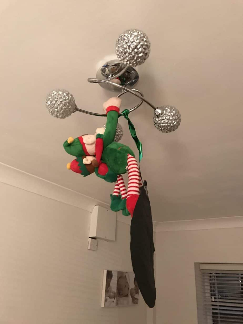 Elf on the shelf ideas - get your elf to hang off a light fixture