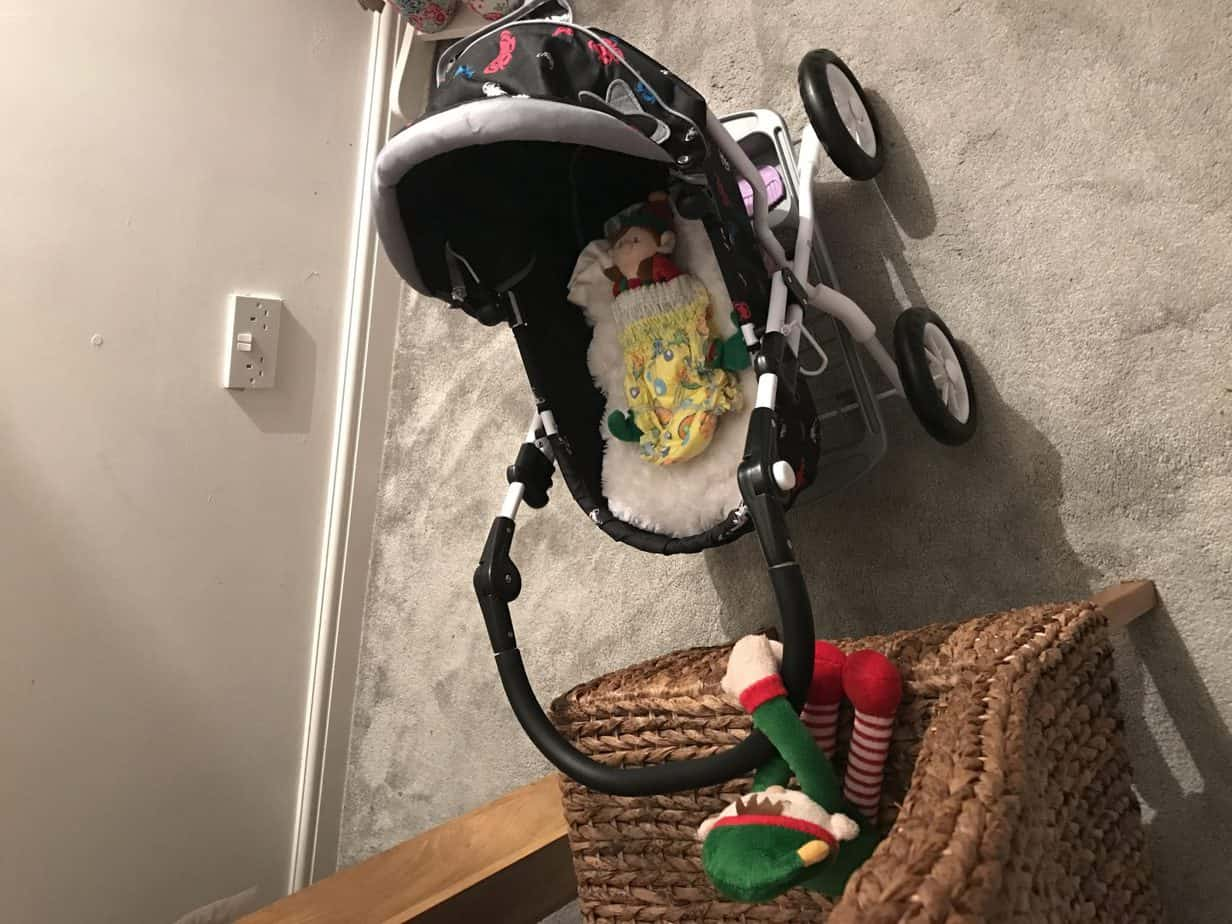 Elf on a shelf ideas - get your elf to go for a walk in the pushchair!