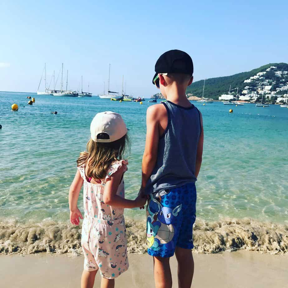 B and W facing out to Sea on Santa Eulalia beach which is my second of my top places to visit in Europe with kids