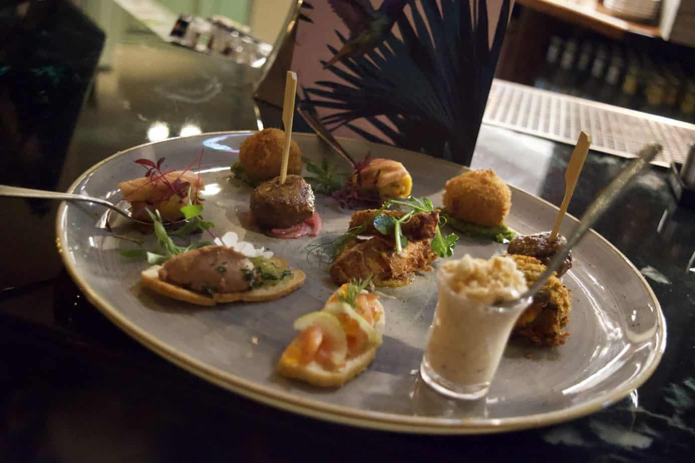 Our plate of canapés including duo liver parfait, falafel, lamb kofta