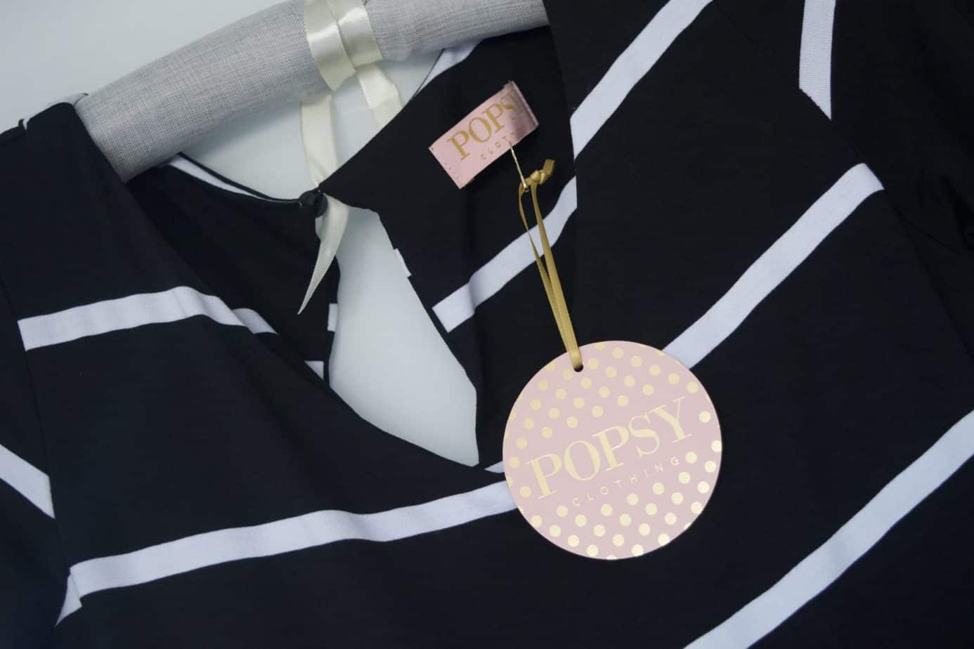 Close up of the Popsey clothing jumpsuit with the tag pink and gold