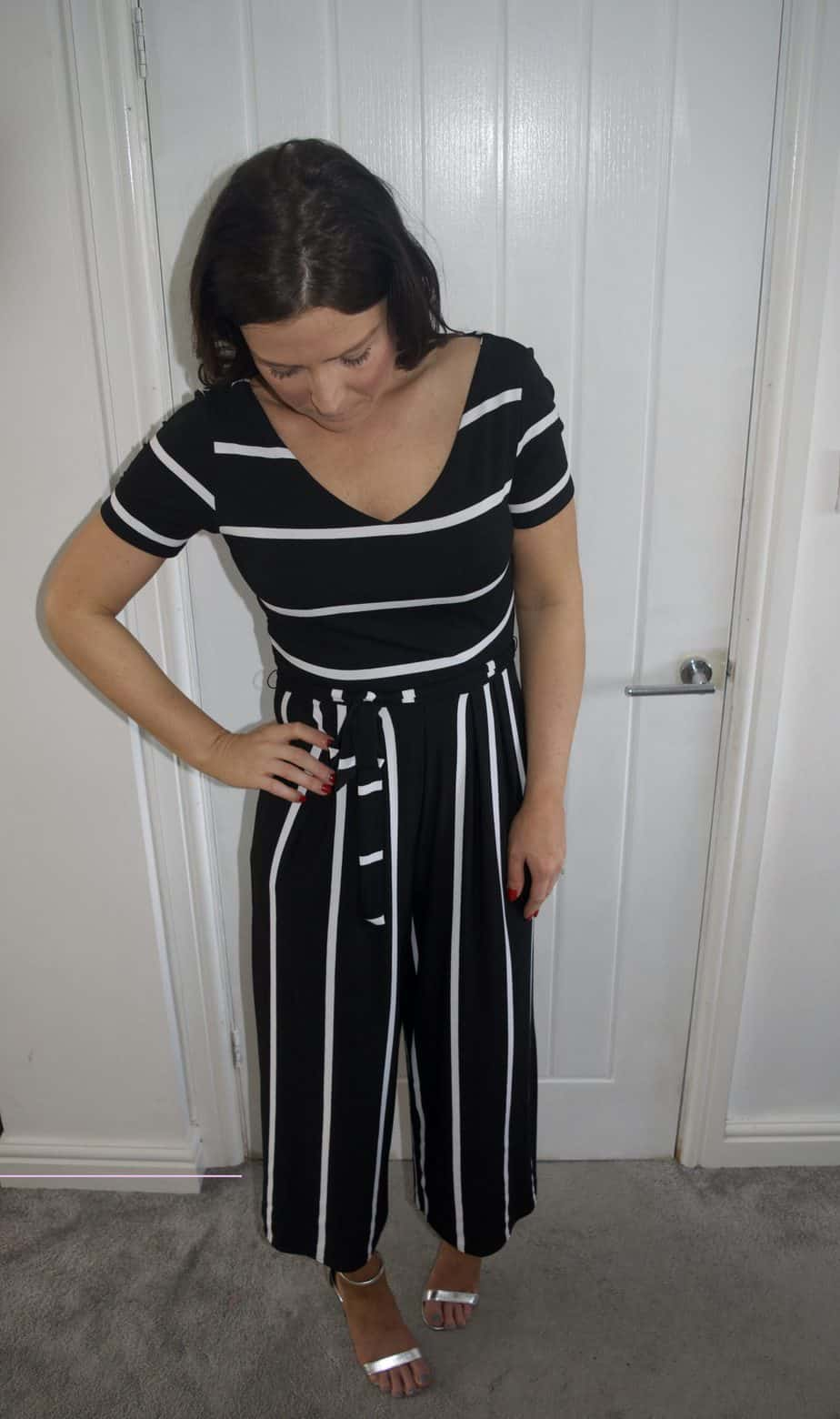 Full length jumpsuit shot with me looking down at my feet