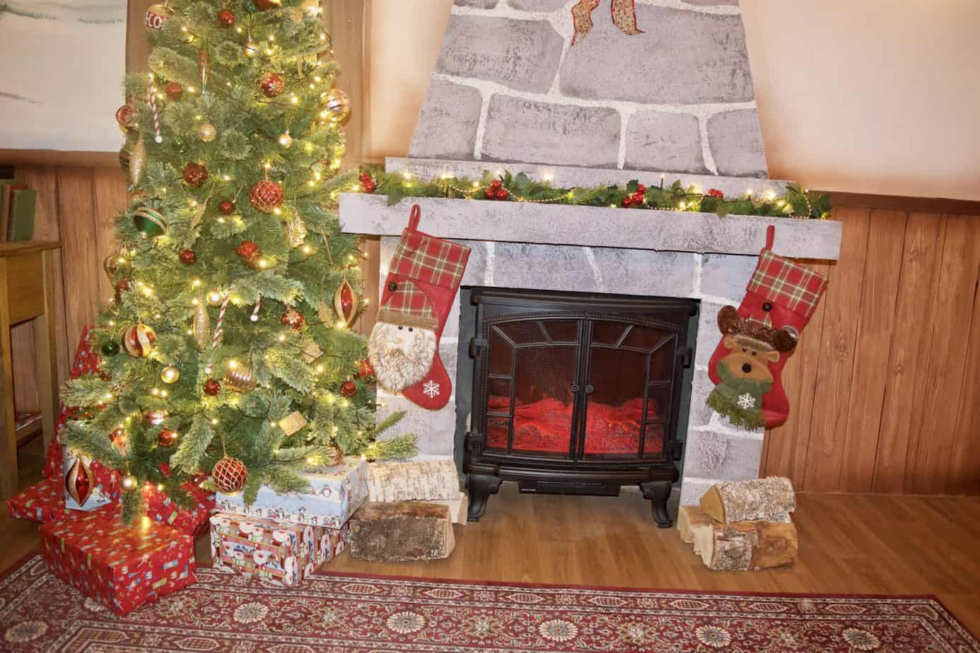 The roaring fire and tree in the Santas Grotto after our Jingle Bells: The Santa Claus Experience