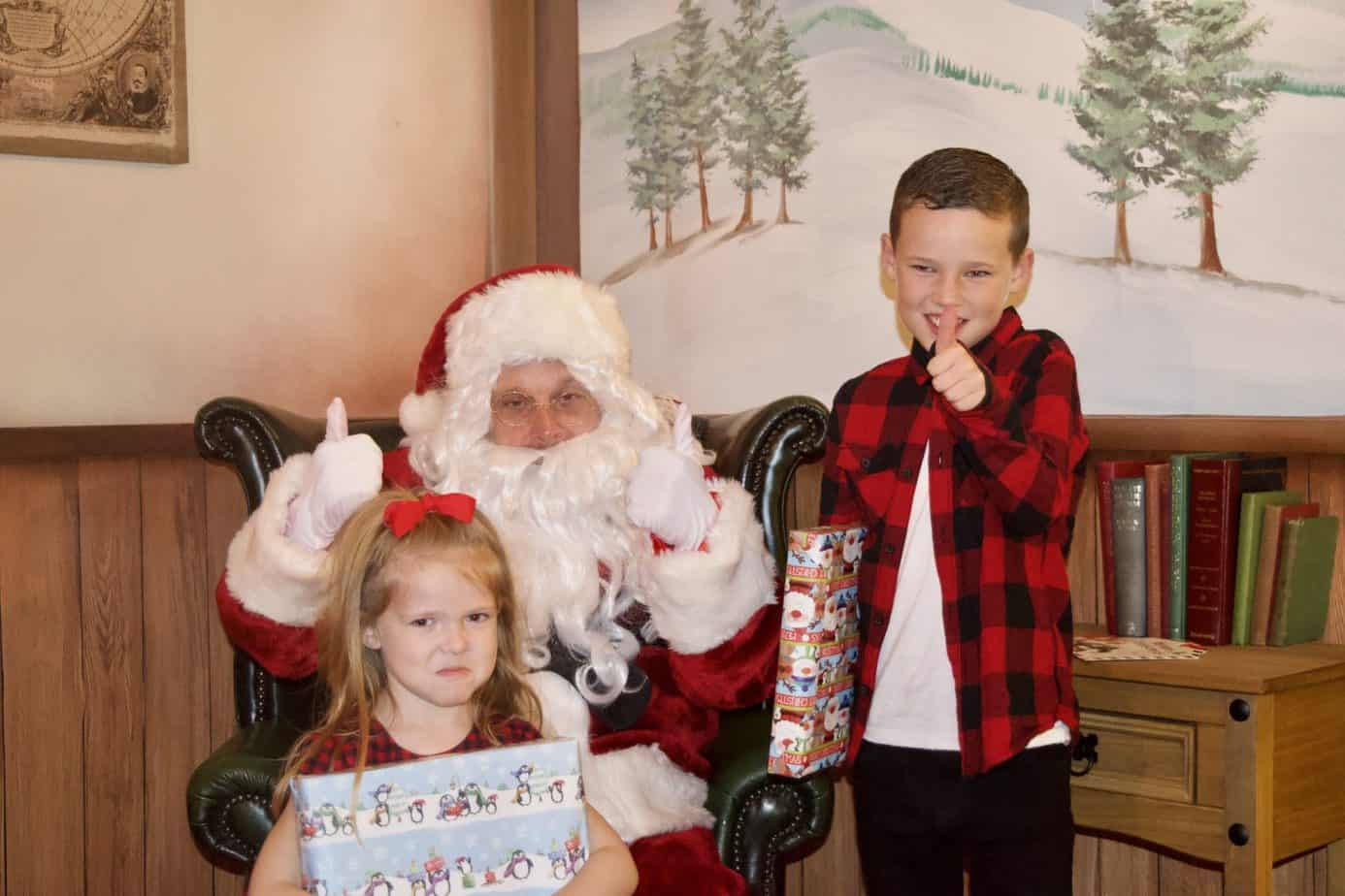 All smiles with their gifts from Santa Clause at Resorts world birmingham