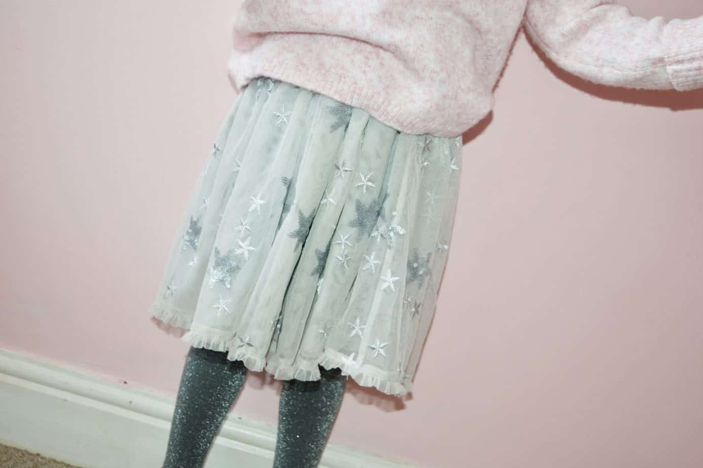 Close up of the dove sequin skirt from Mintie by Mint Velvet with star detail