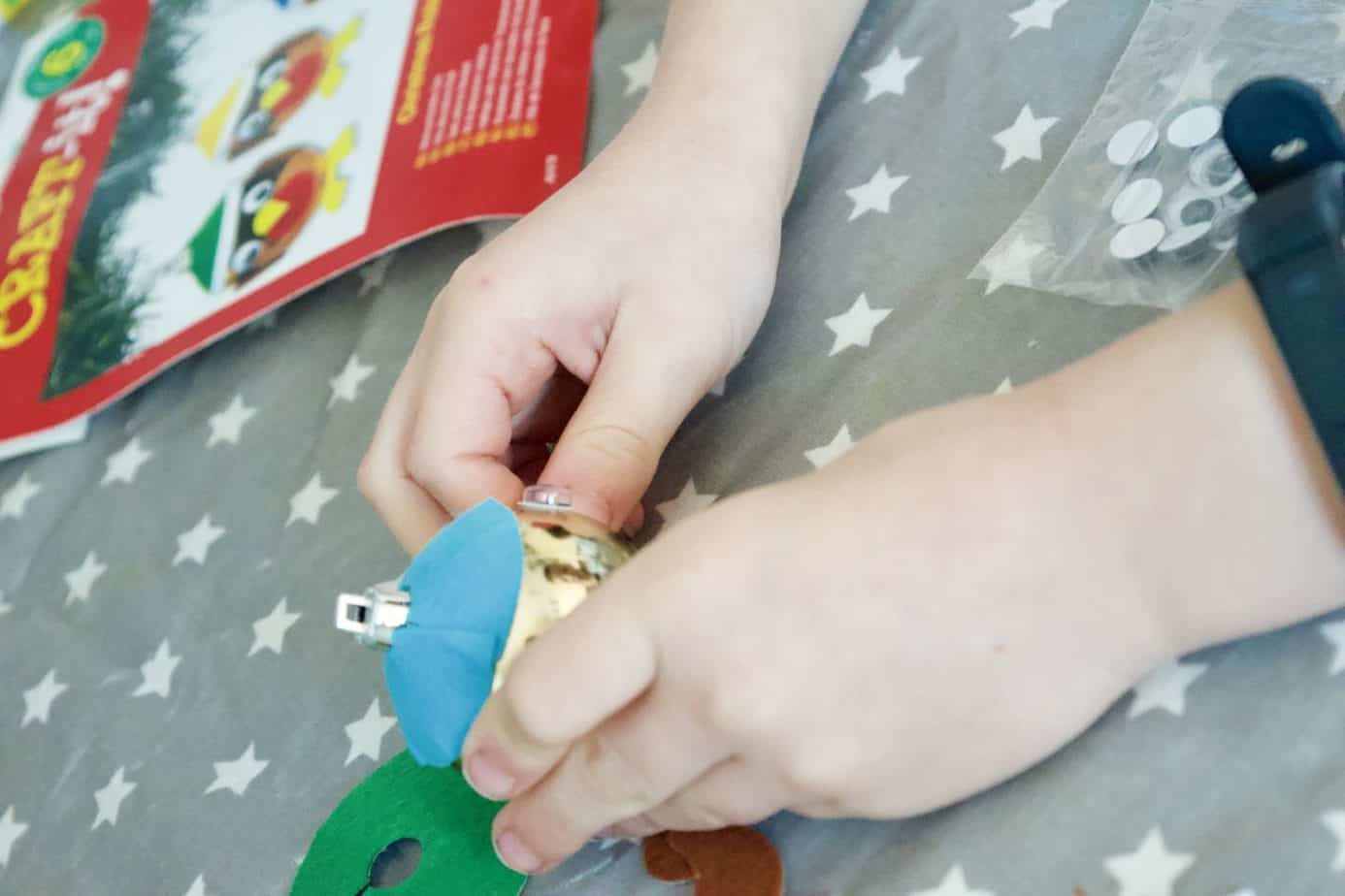 Mr B getting his Robin bauble christmas crafts decoration ready to hang on our Christmas Tree