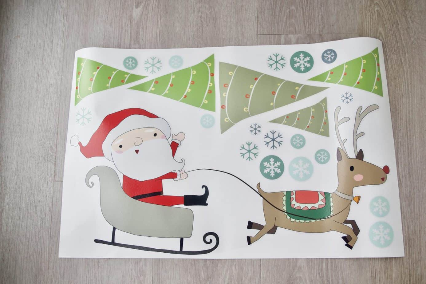 Our window stickers featuring santa on his sleigh, trees and snow flakes