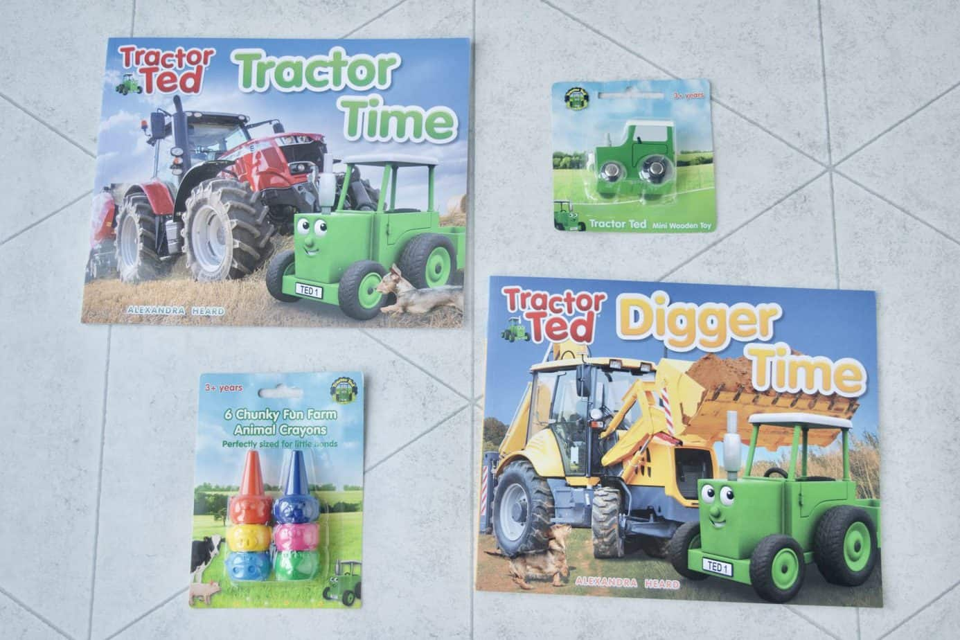 Our lovely items from Tractor Ted including 2 x books, a wooden toy and a pack of crayons