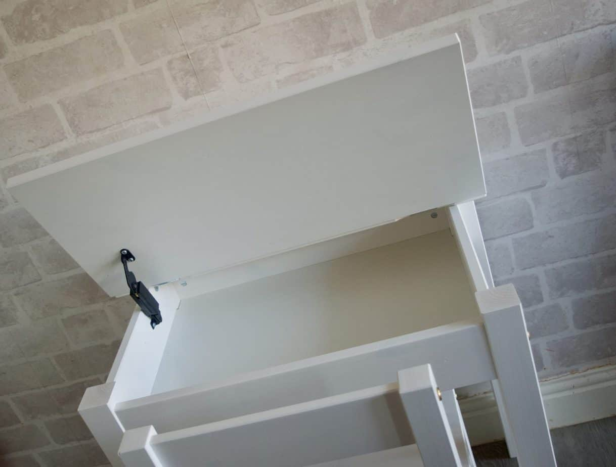 The child's desk has a compartment for storage
