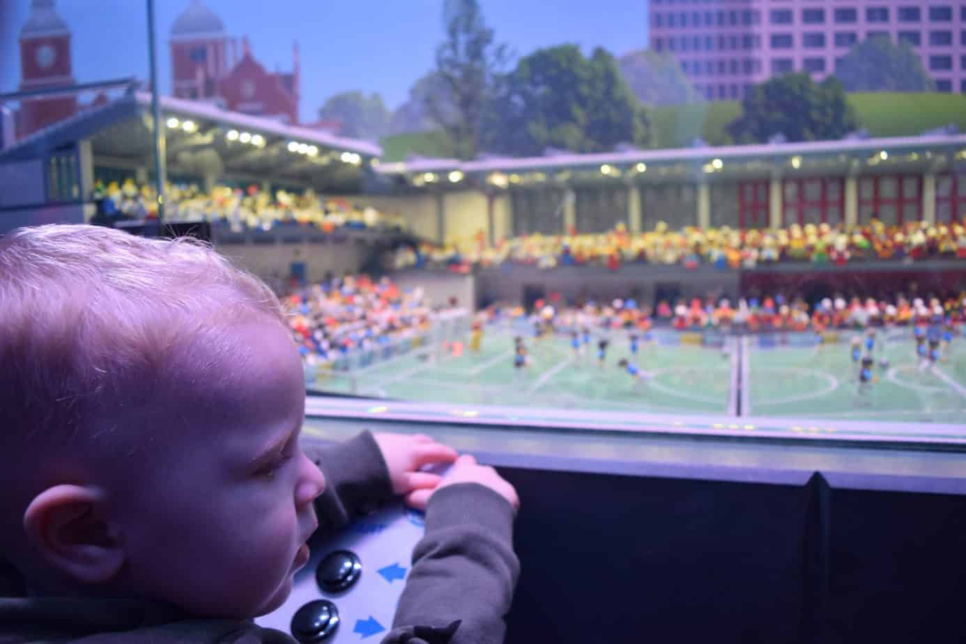 Baby K looking at a Lego football match