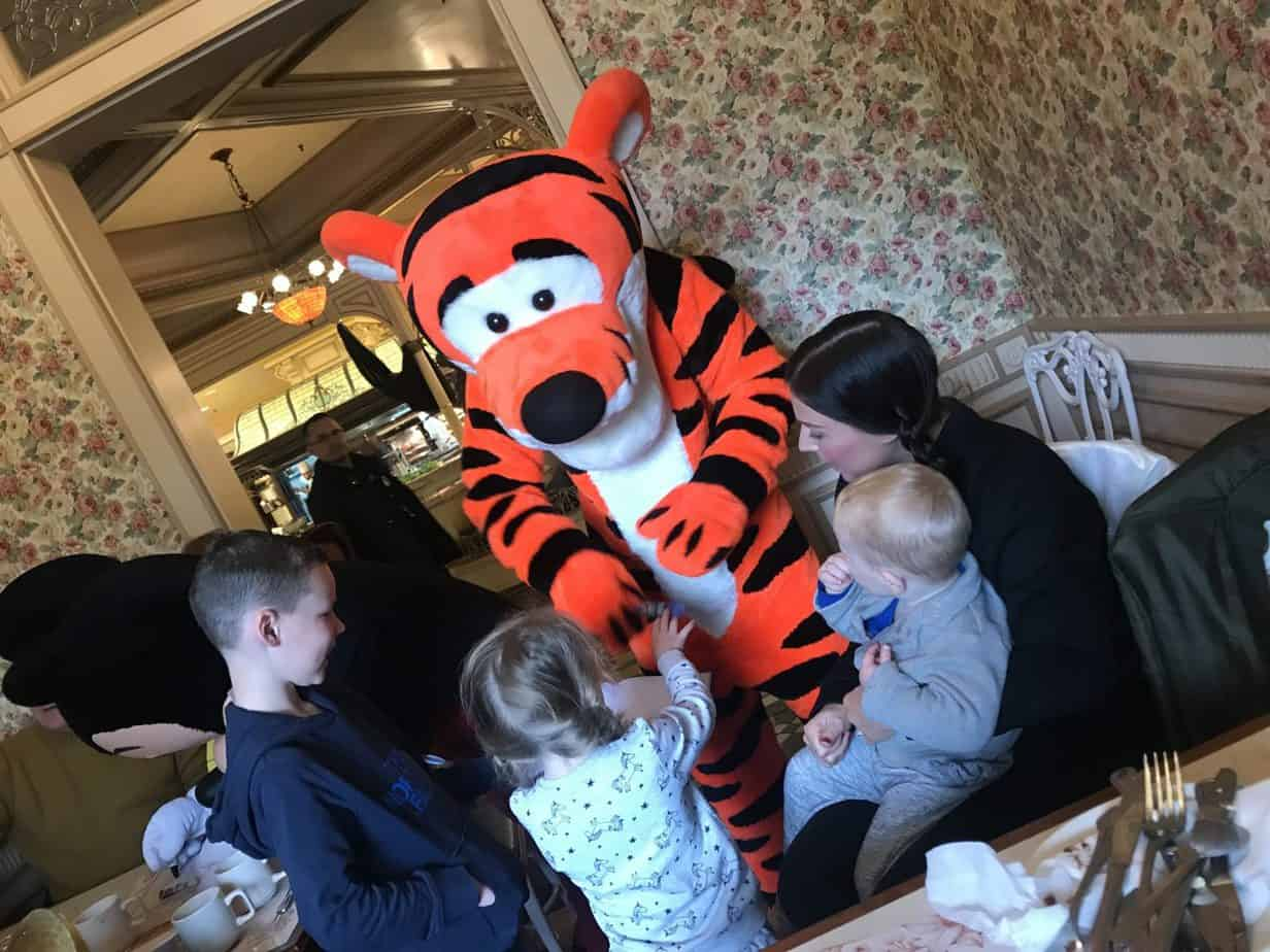 The kids meeting Tigger at the Character Breakfast at Disneyland Paris and getting their autograph booked signed