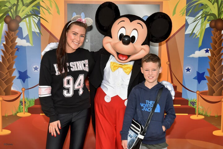 Mr B and I meeting the Mickey Mouse at Disneyland Paris