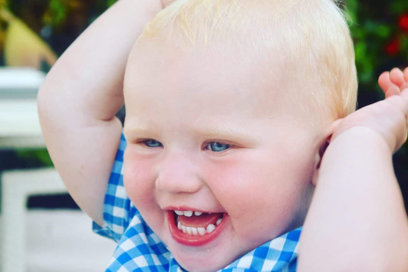 Baby K smiling