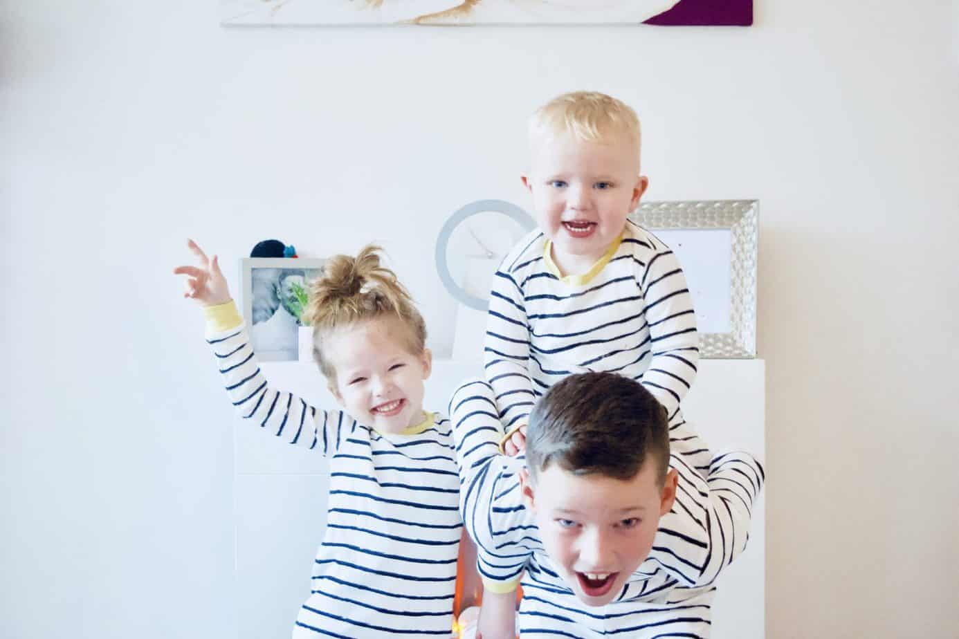 Kids in their organic cotton pyjamas Mr B has Baby k on his back and all are smiling