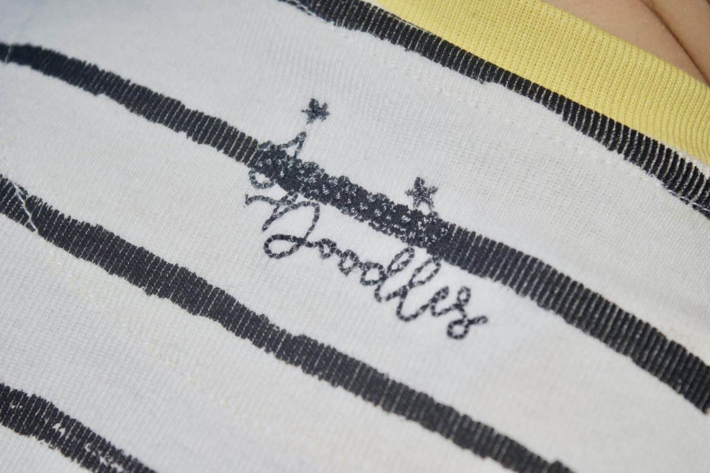 Close up of Jammie doodles logo printed on the back of the top