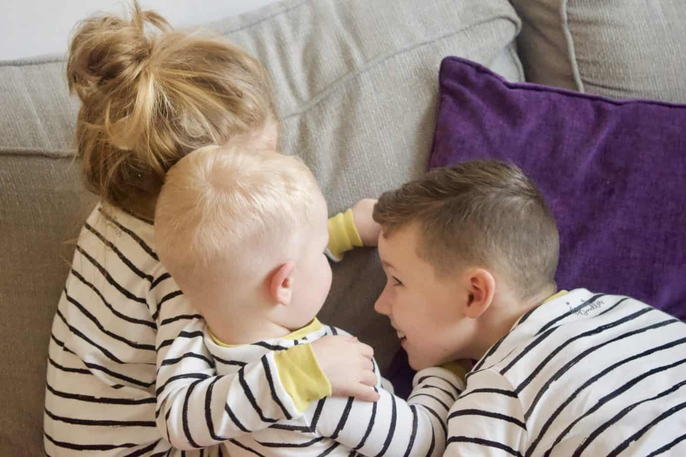 All three kids facing away from the camera wearing their jammie doodle pyjamas