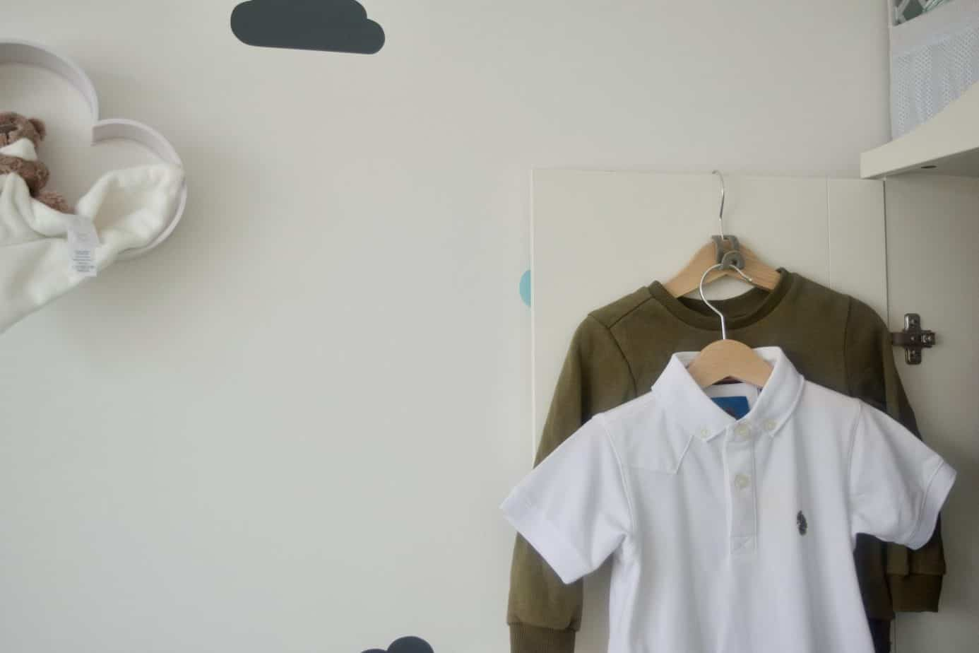 space savers on hanger showing an outfit for Baby K hanging on the inside of his open wardrobe door