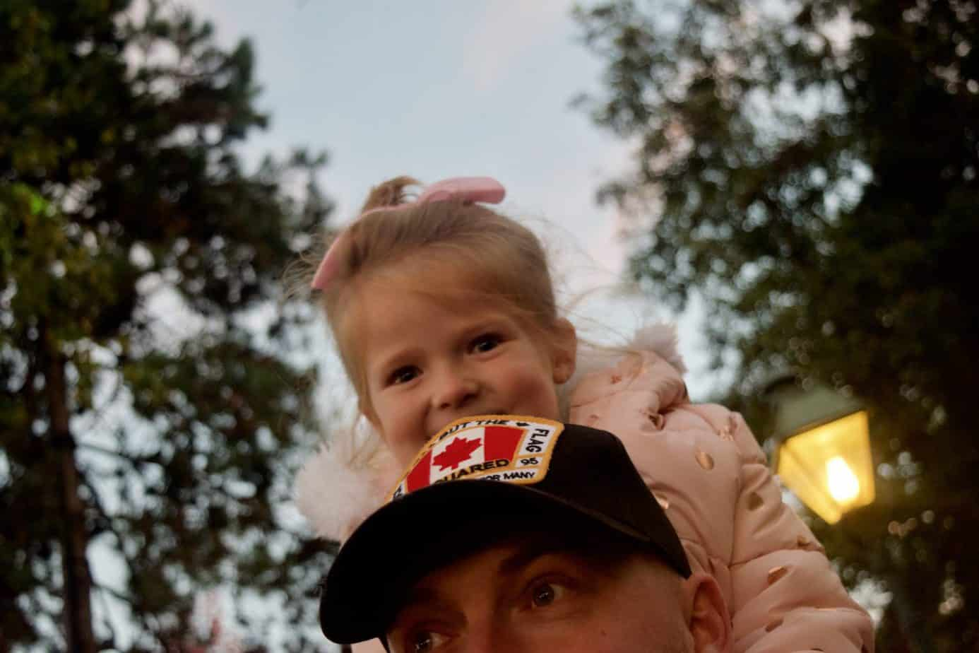 Miss W on her Dads shoulders waiting for the Parade