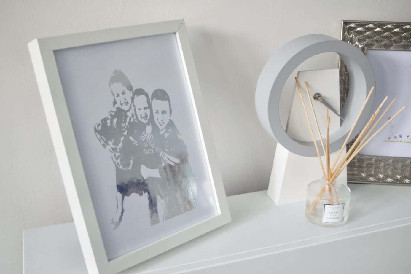 OhMyGold LDN personalised foil print featuring my three kids in silver on my fireplace