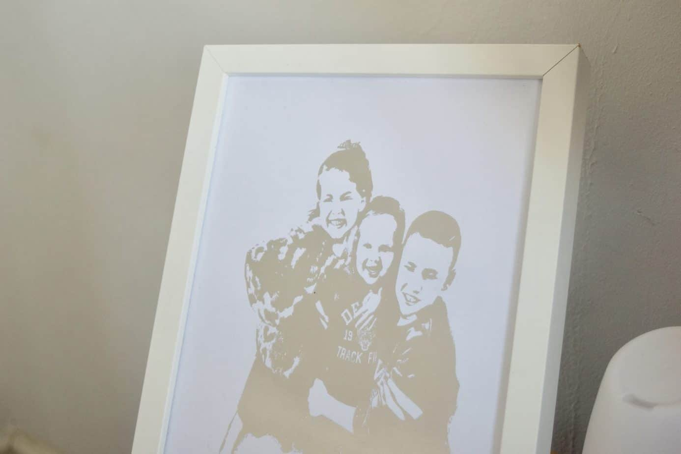 Close up of the personalised foil print in silver with the three kids