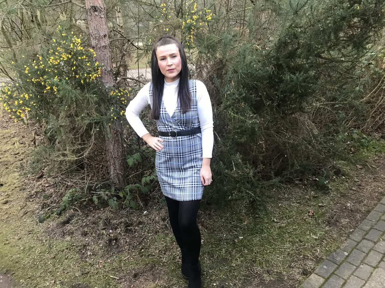Pinafore Dress with white long sleeved top underneath styled on me by Quiz clothing