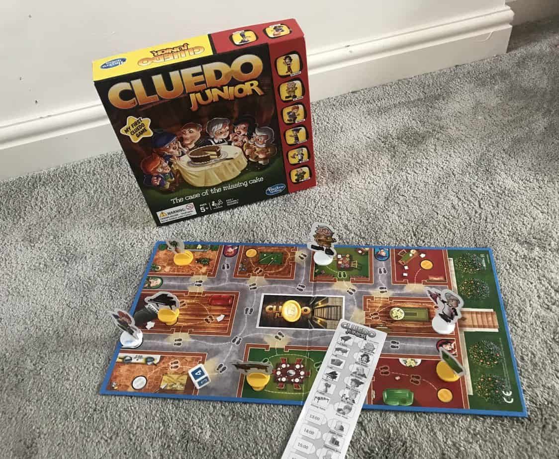Junior Cluedo and Box, with the board game and counters on the game - top board game for 4 and 8 year olds