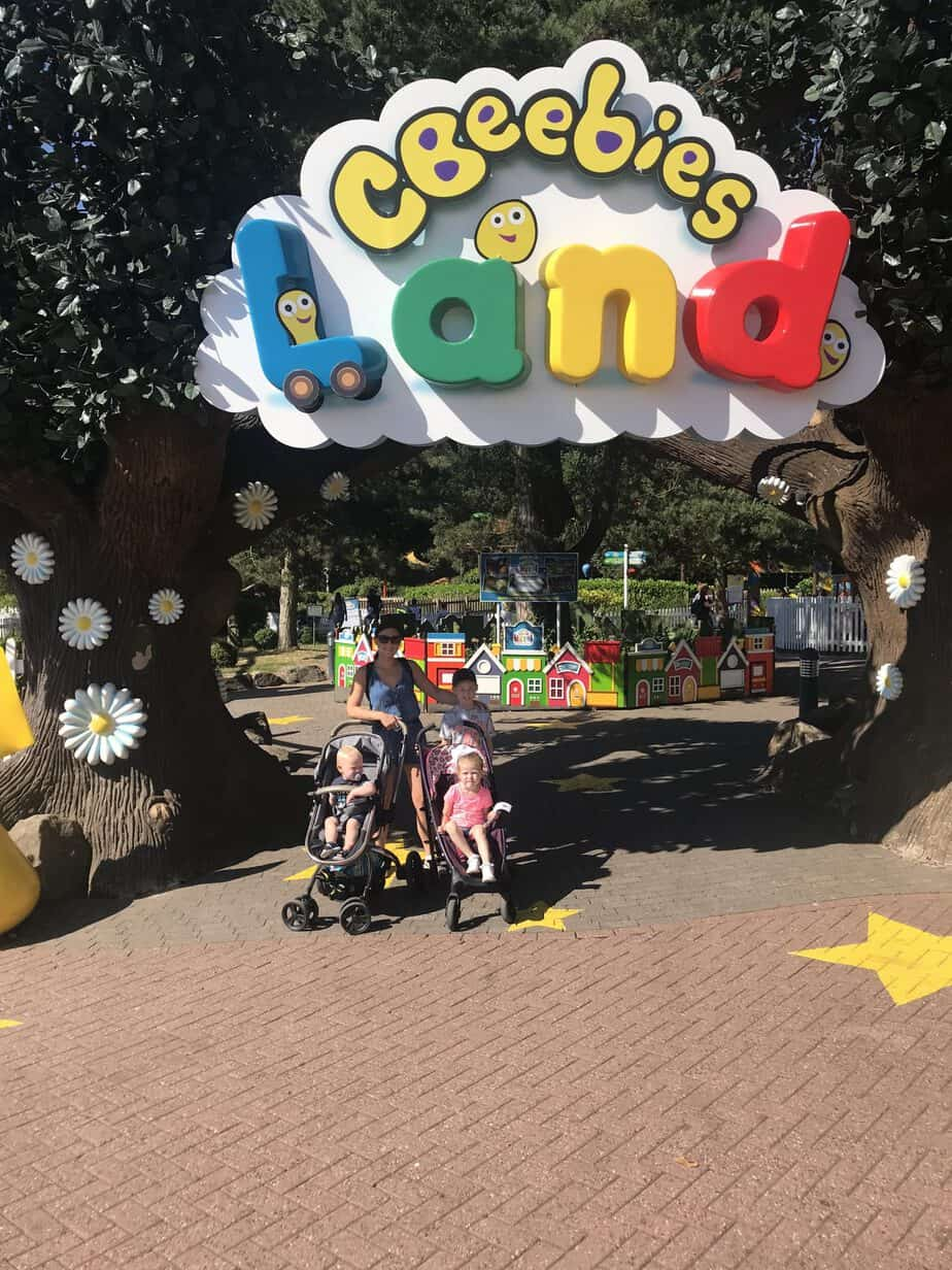 Us standing outside the Cbeebies Land Sign at Alton Towers