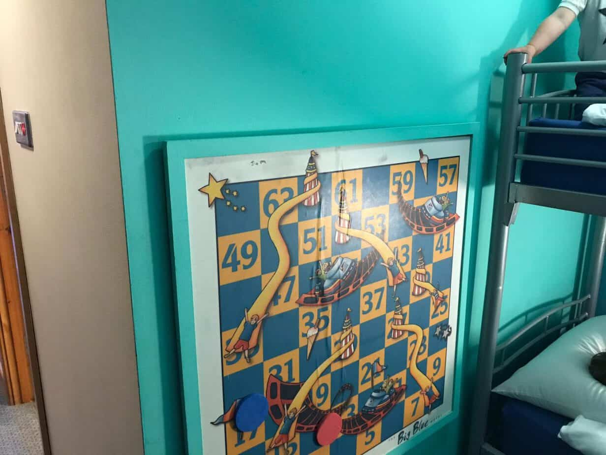 snakes and ladders board at the big blue hotel deluxe family room