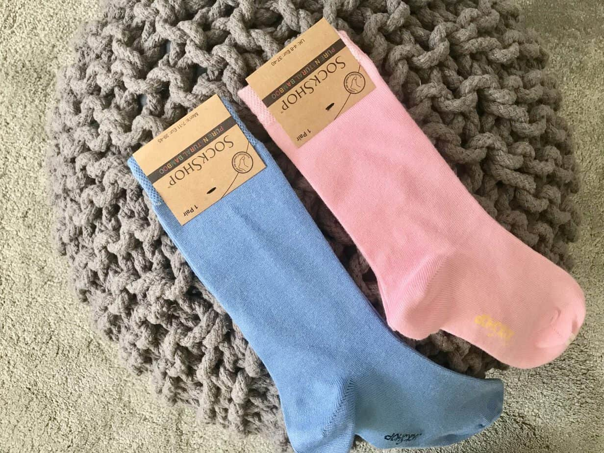 Mens blue bamboo socks and womens pink bamboo socks from Sockshop