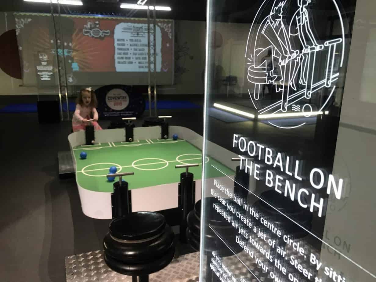 Football on a bench at move and play exhibition coventry transport museum