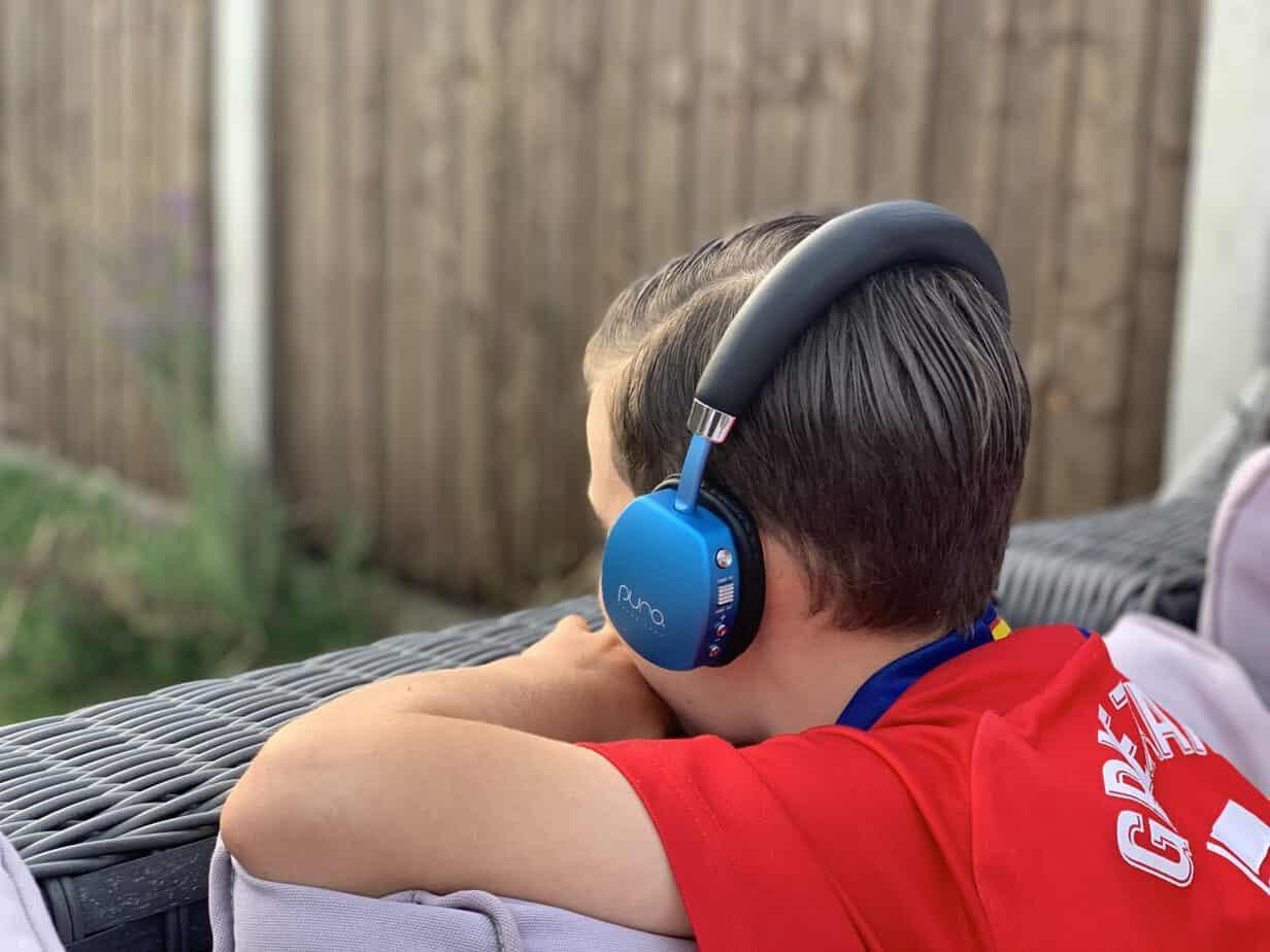 Mr B wearing his Puro Lab's Puroquiet wireless headphones in blue