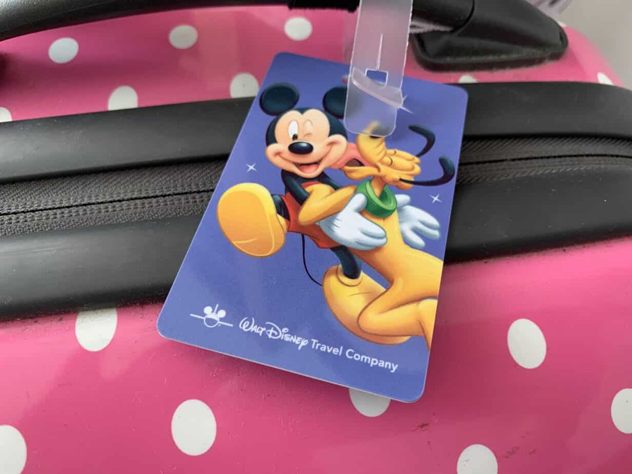 our disney luggage tags all ready on our hand luggage