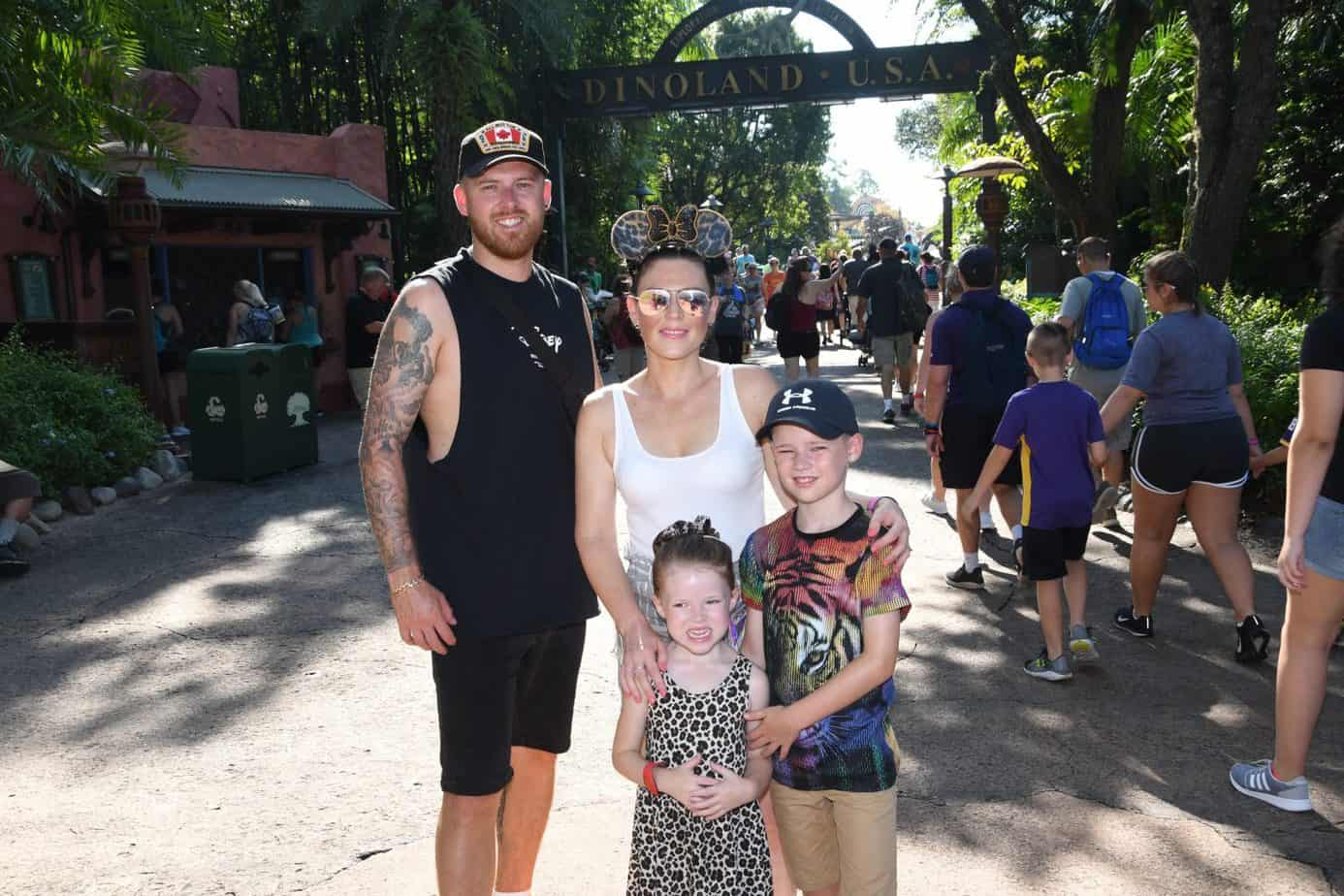 Family photo outside Dinoland in Animal Kingdom