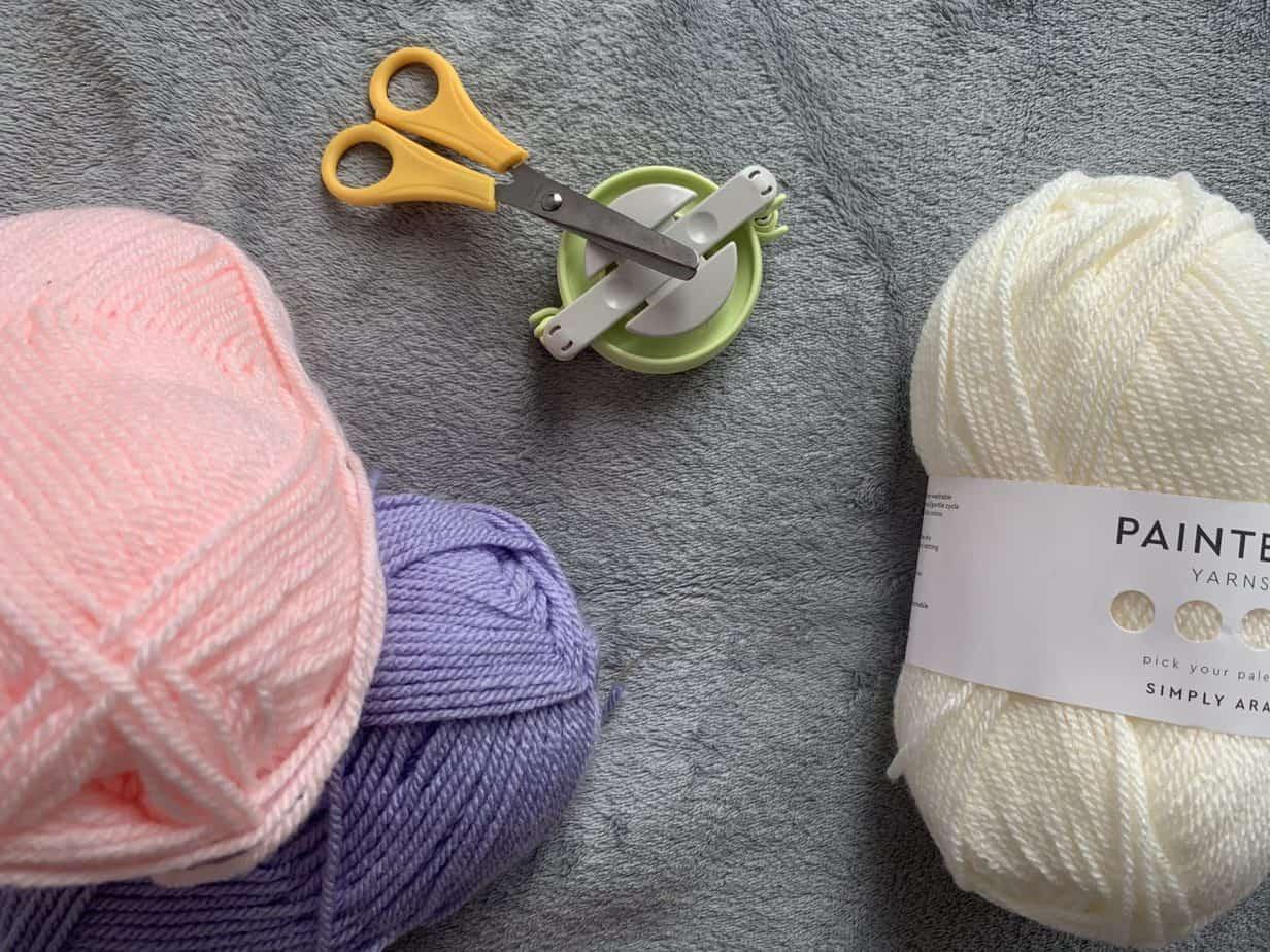 Lovecrafts yarn and small pom pom maker