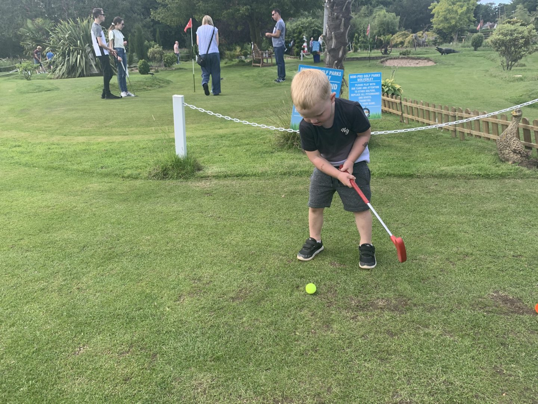 Teeing off at Mini Golf Pro Park Kiddemister