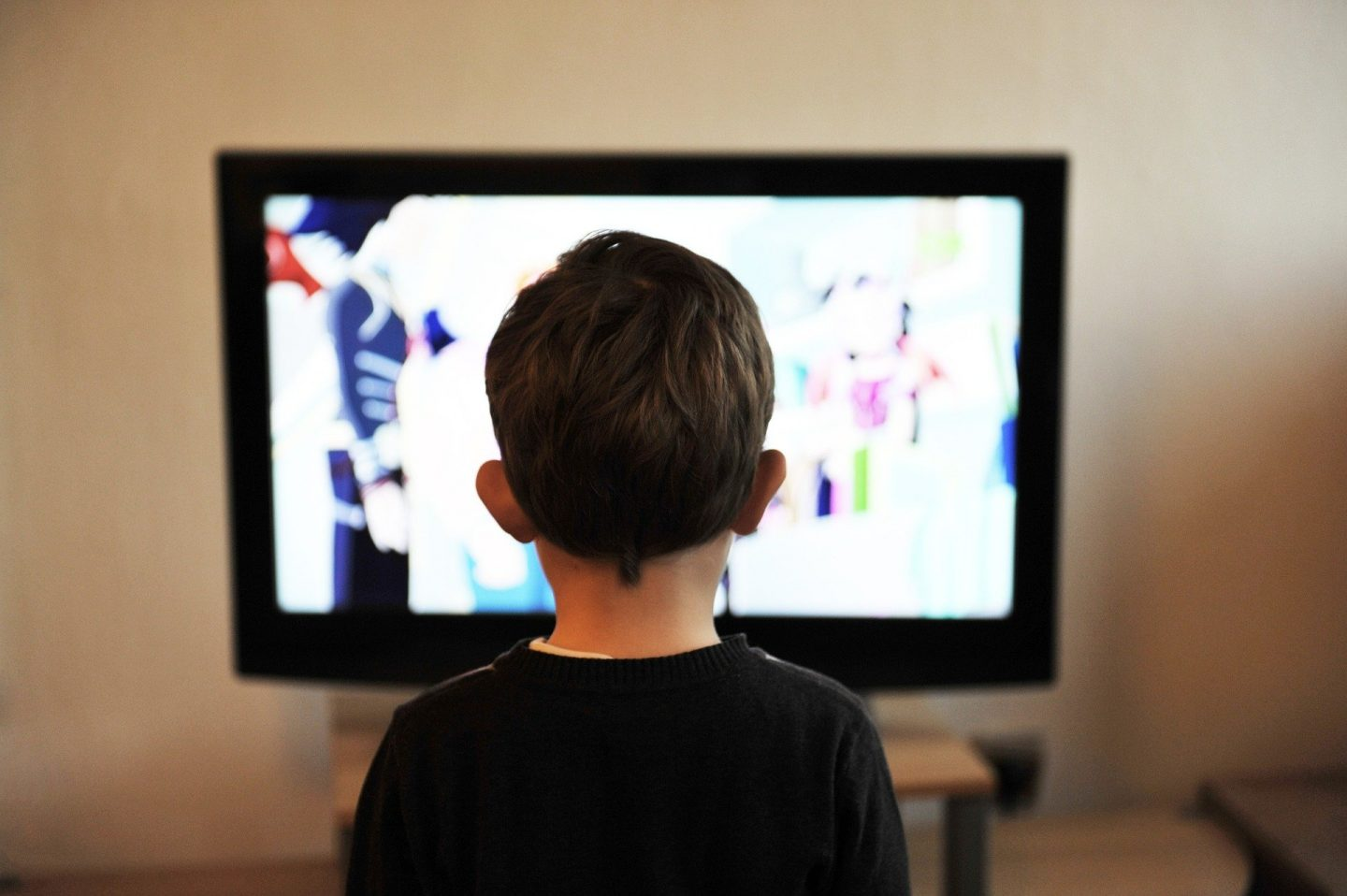 child watching tv to support their learning in a new language