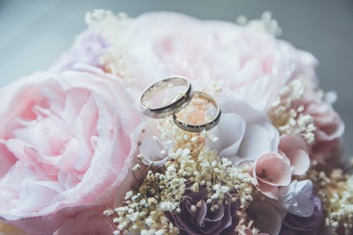 Two wedding rings on some flowers