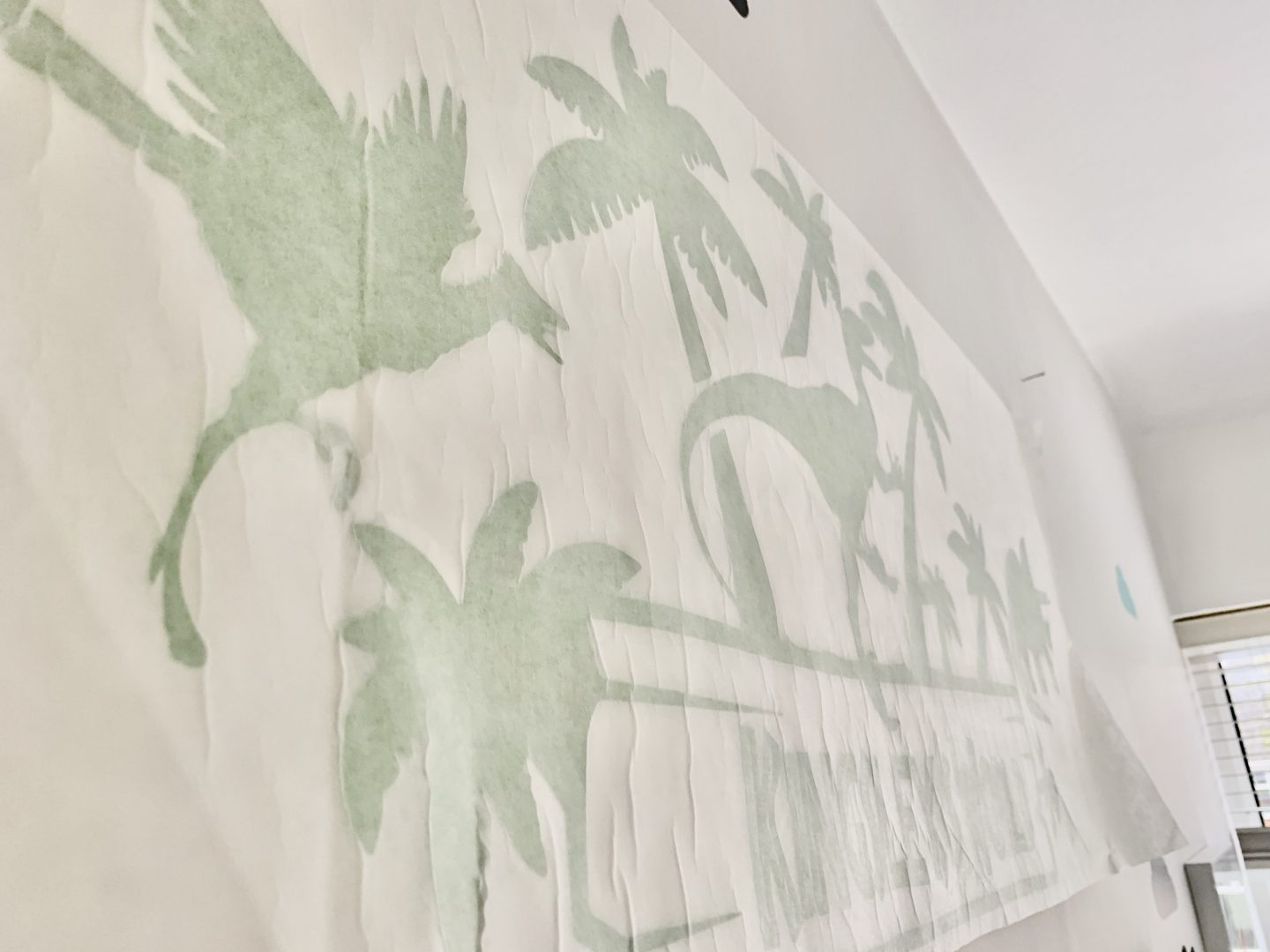 Transferring dinosaur themed wall sticker into wall from JR Decal