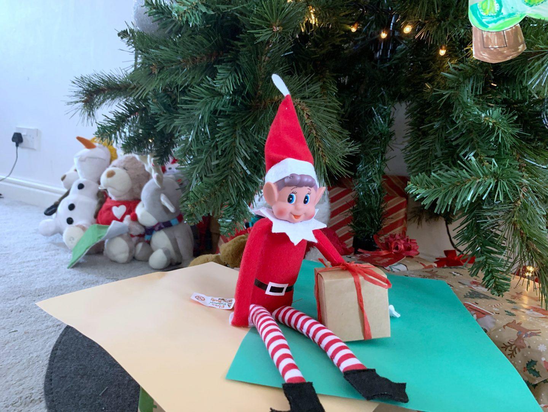 Gift box full of chocolates elf on a shelf idea