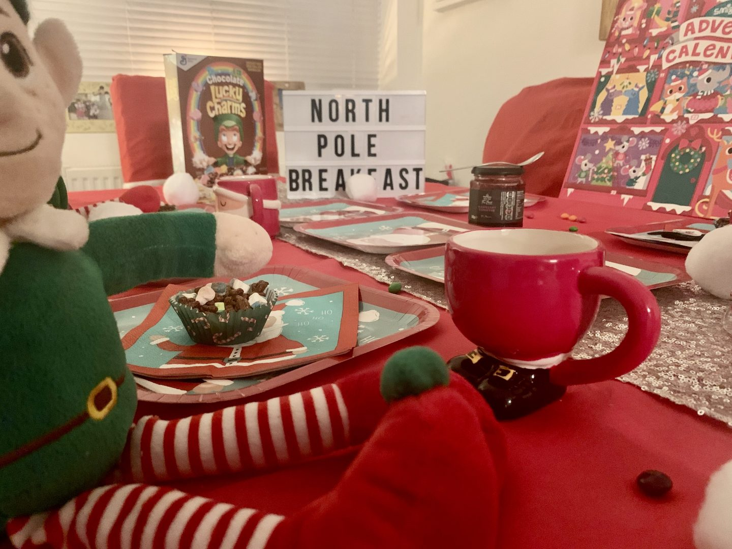 Using santa mugs for our north pole breakfast