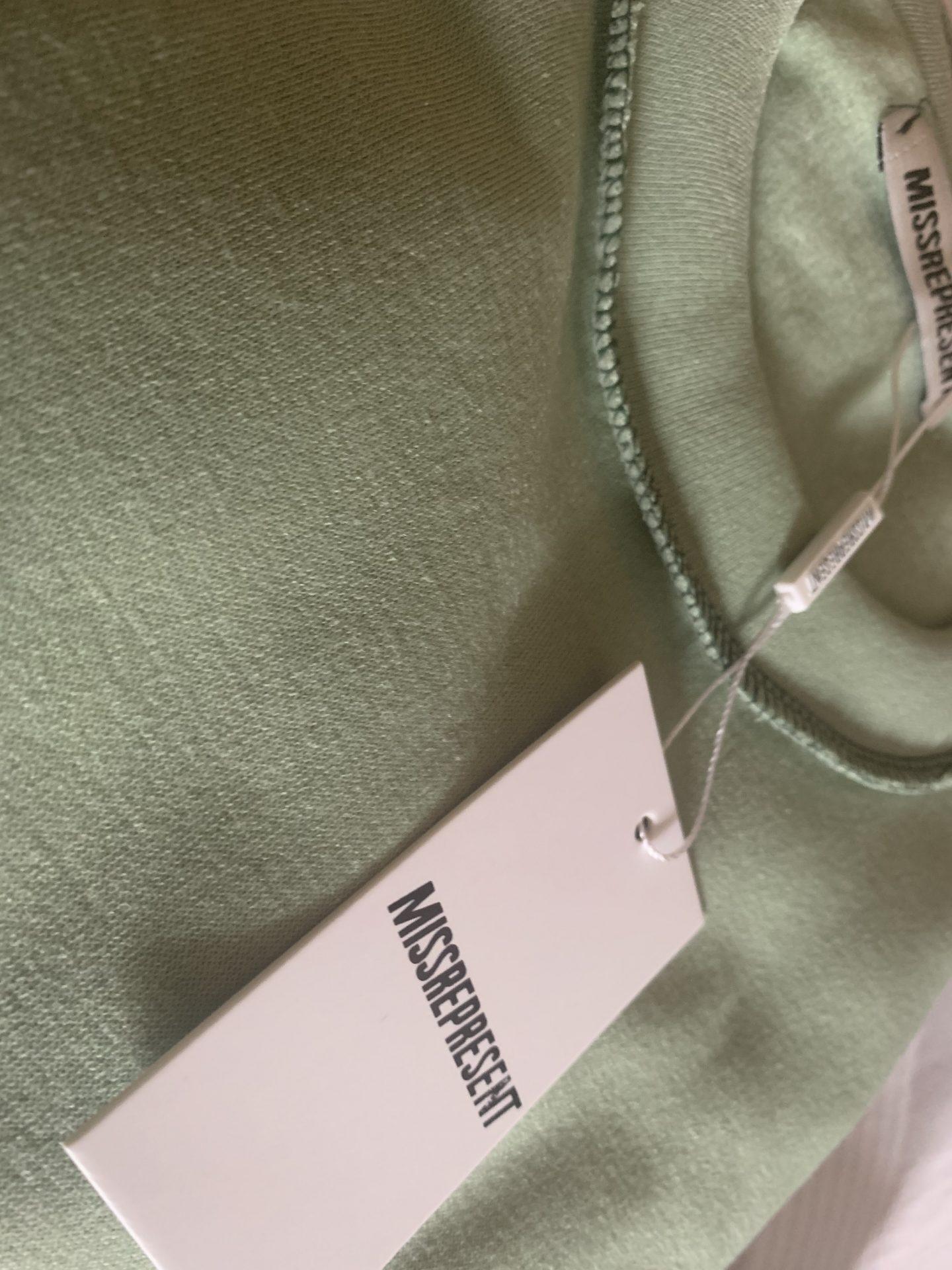 MREP tag on green tracksuit