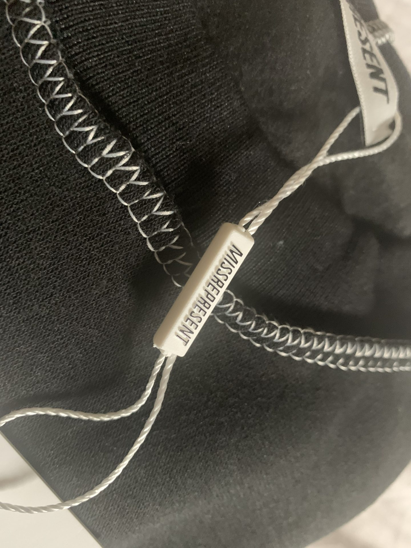 MREP clothing black tracksuit tag with stitch detail