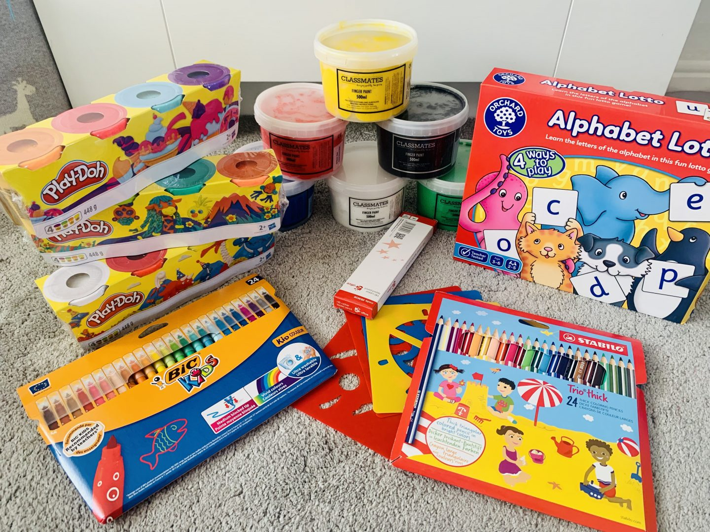 selection of items from office stationery including play dog, stationery and orchard toys